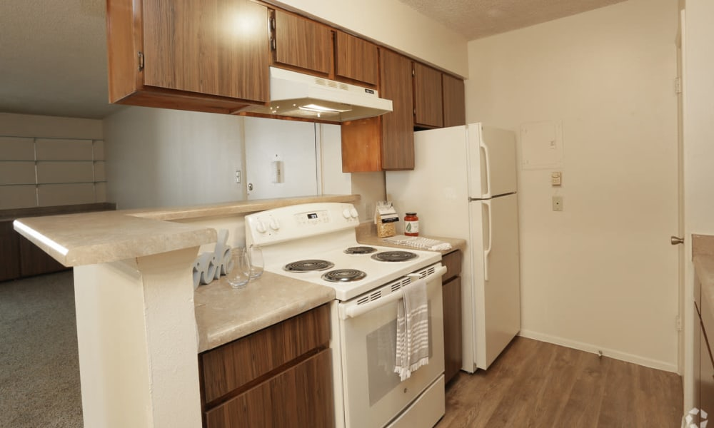 Open kitchen with see through bar at High Ridge Apartments in El Paso, Texas