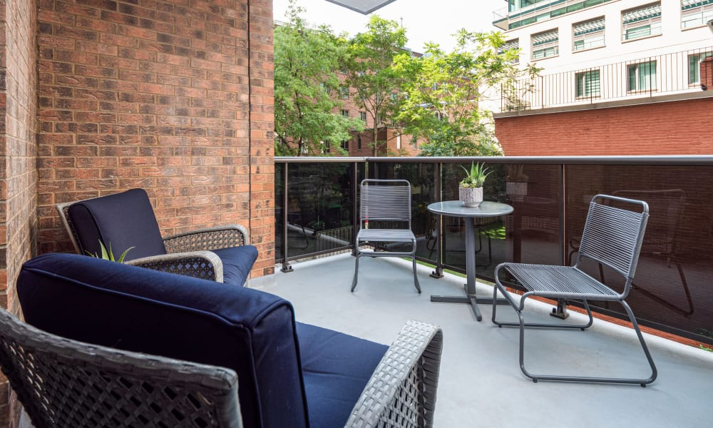 Large patio with seating at 57 Charles at Bay in Toronto, Ontario