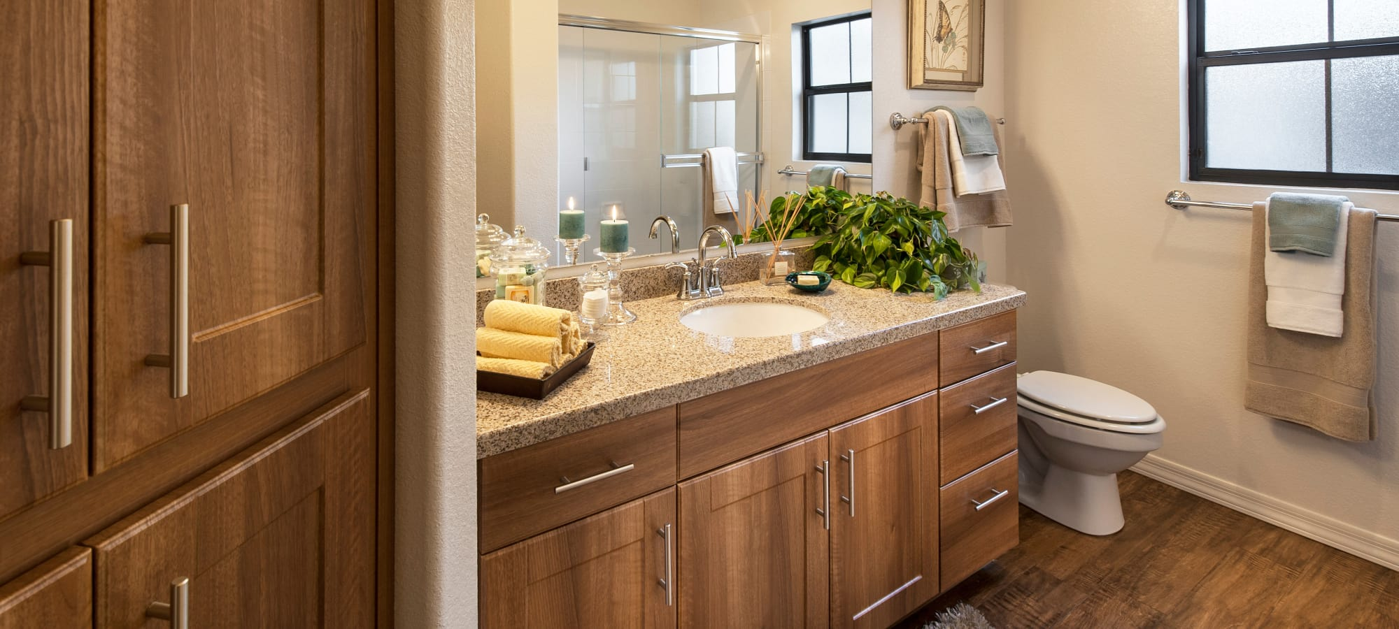 Luxurious bathroom with wood cabinets in model home at San Capella in Tempe, Arizona