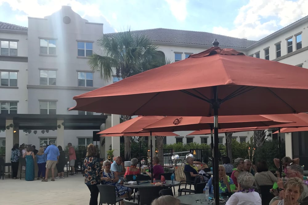 Residents enjoying the courtyard at Merrill Gardens at ChampionsGate in ChampionsGate, Florida.