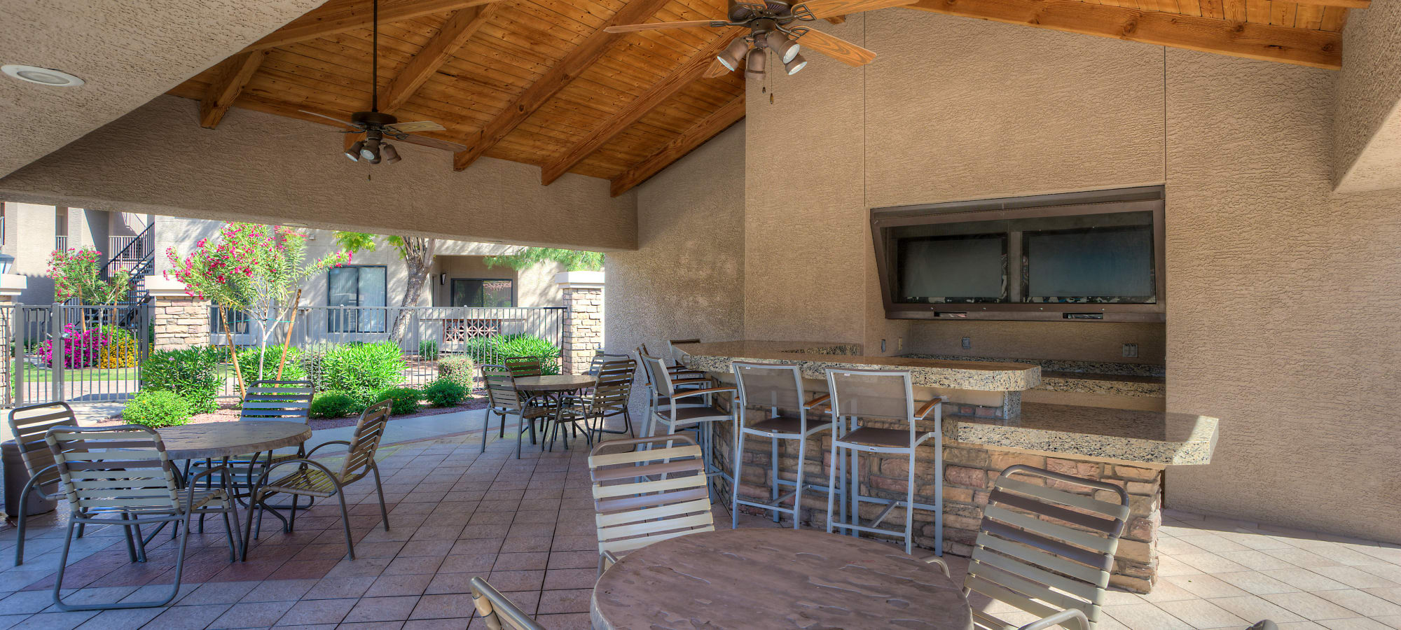 Covered outdoor seating in one of the common areas at San Pedregal in Phoenix, Arizona