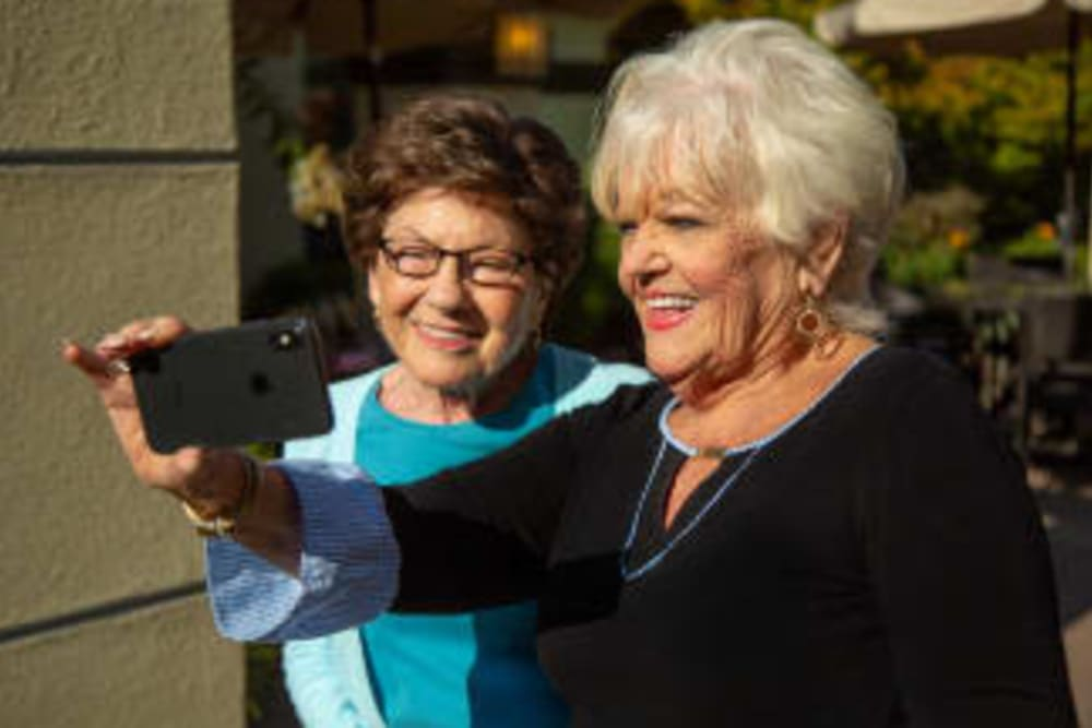 Two residents taking a selfie at Courtyards at Berne Village in New Bern, North Carolina