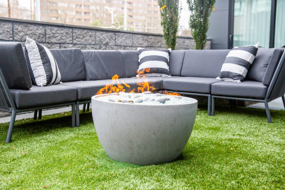 An outdoor fire pit with couches at Belcourt Park in Nashville, Tennessee
