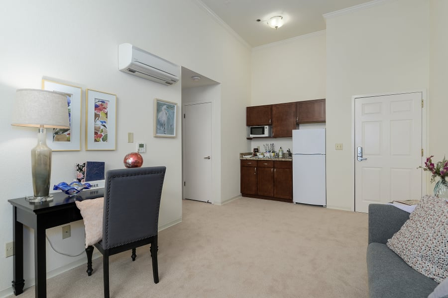 Living area and kitchen in suites at Palo Alto Commons in Palo Alto, California