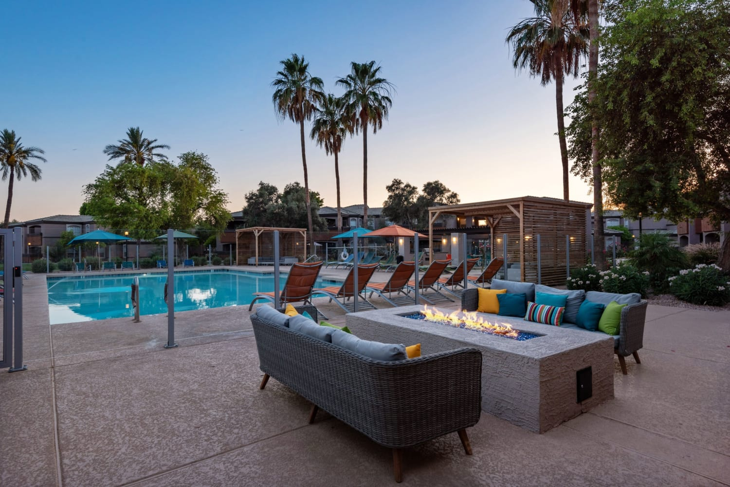Firepit seating by the pool at Luxe @ Ocotillo in Chandler, Arizona