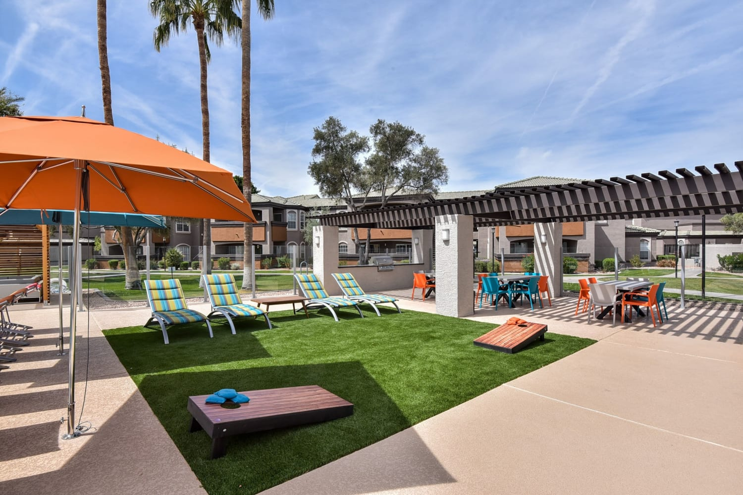 Outdoor patio and lawn games at Luxe @ Ocotillo in Chandler, Arizona