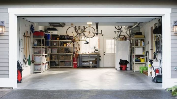 a garage is organized with shelving to allow for a car