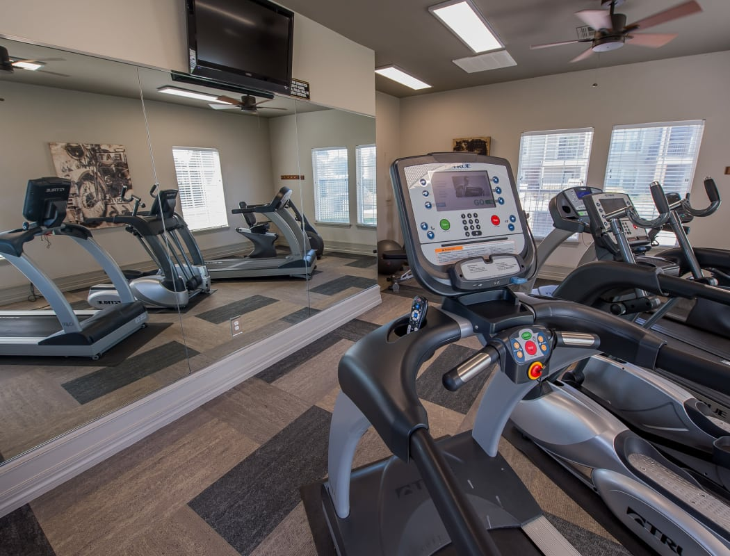 Well equipped fitness center at The Remington Apartments in Wichita, Kansas