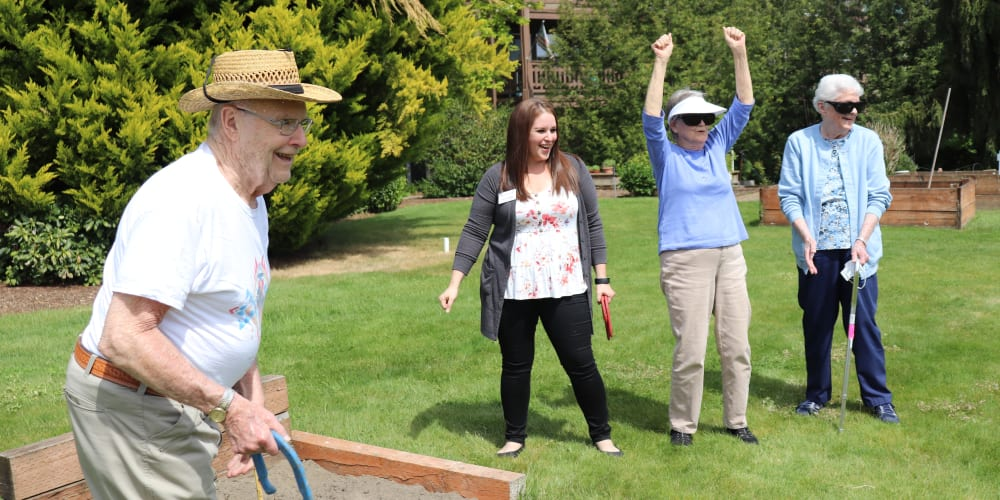 Residents having fun playing horseshoe at The Springs at Sunnyview in Salem, Oregon