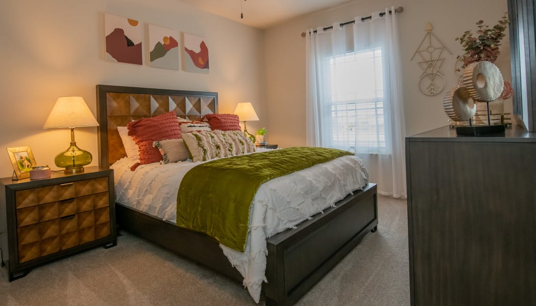 Bedroom furnished with tons of natural light at Artisan Crossing in Norman, Oklahoma