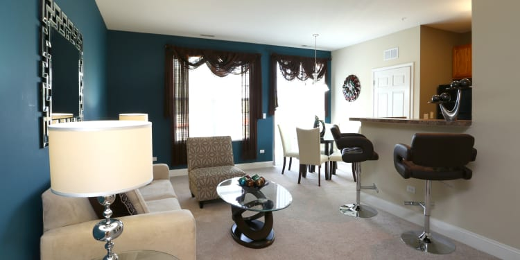 Well-decorated living room in model home at The Preserve at Osprey Lake