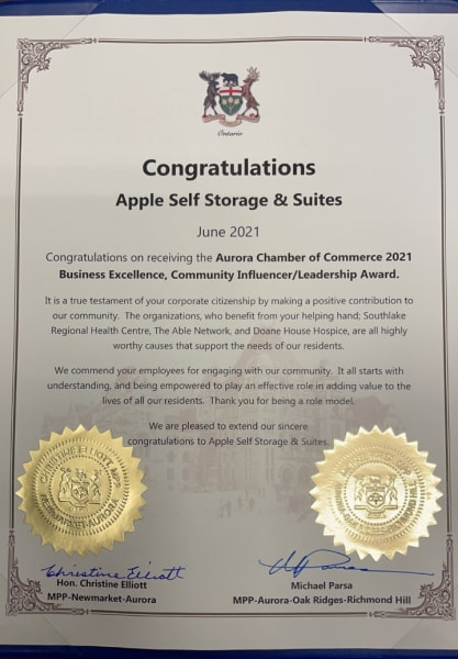 congratulatory scroll presented to apple self storage and suites
