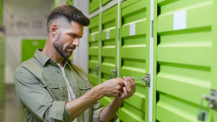 A man unlocking a storage unit