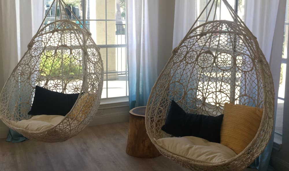 Suspended clubhouse lounge chairs at Azure Apartments in Corpus Christi, Texas
