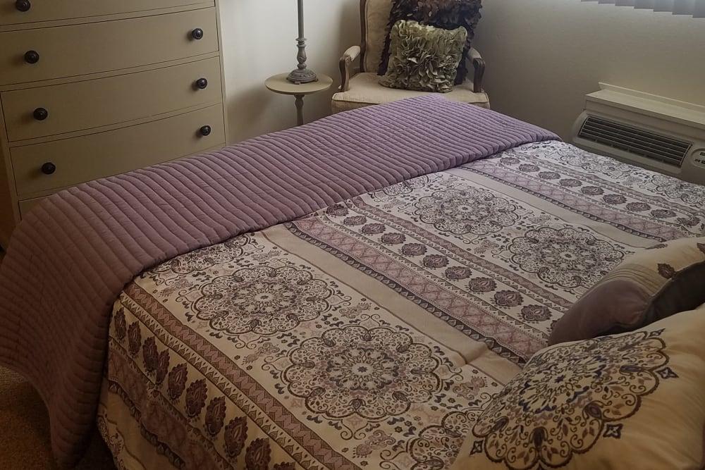 Bedroom at Royal Columbian Retirement Inn