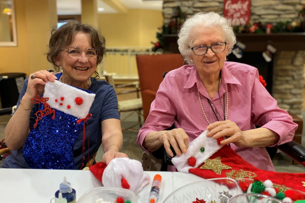 two senior residents making stockings for a Holiday party