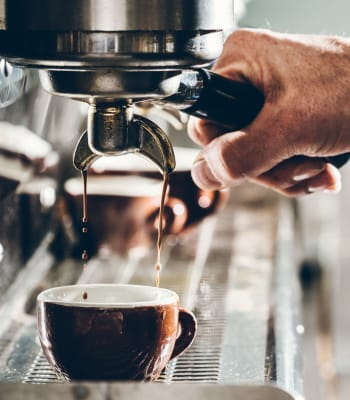 Local coffee shop making an espresso for a resident who lives near Deer Valley Apartment Homes in Roseville, California