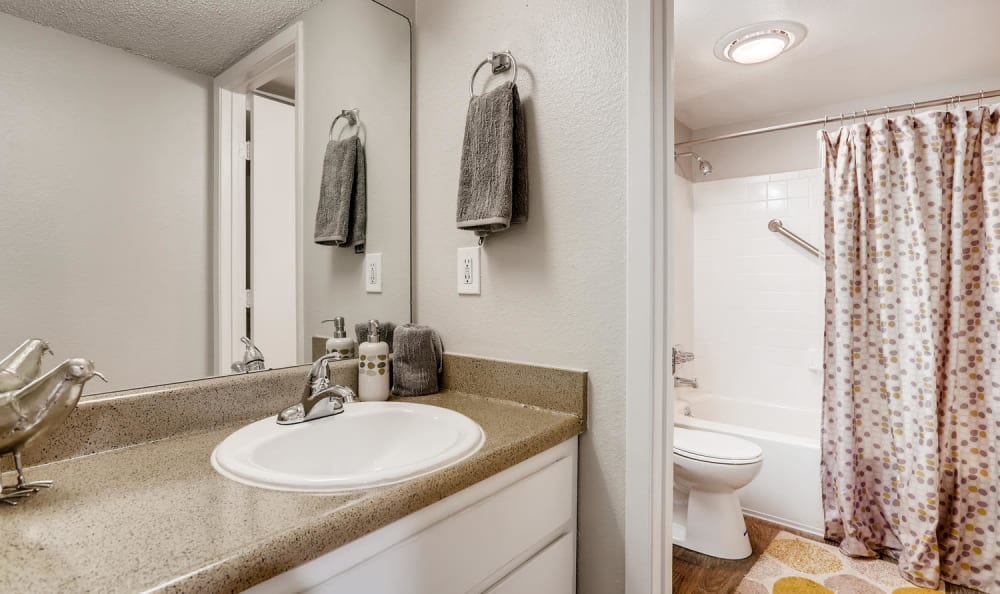 Beautiful apartment bathroom at The Ranch at Bear Creek Apartments & Townhomes in Lakewood, Colorado
