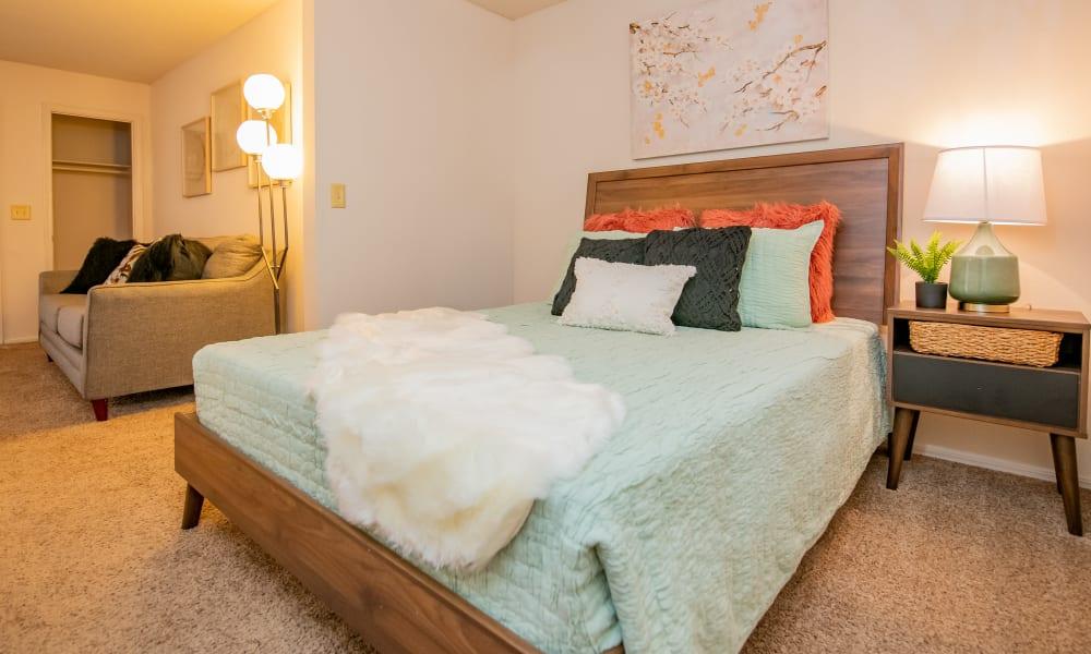 Studio bedroom at Raintree Apartments in Wichita, Kansas