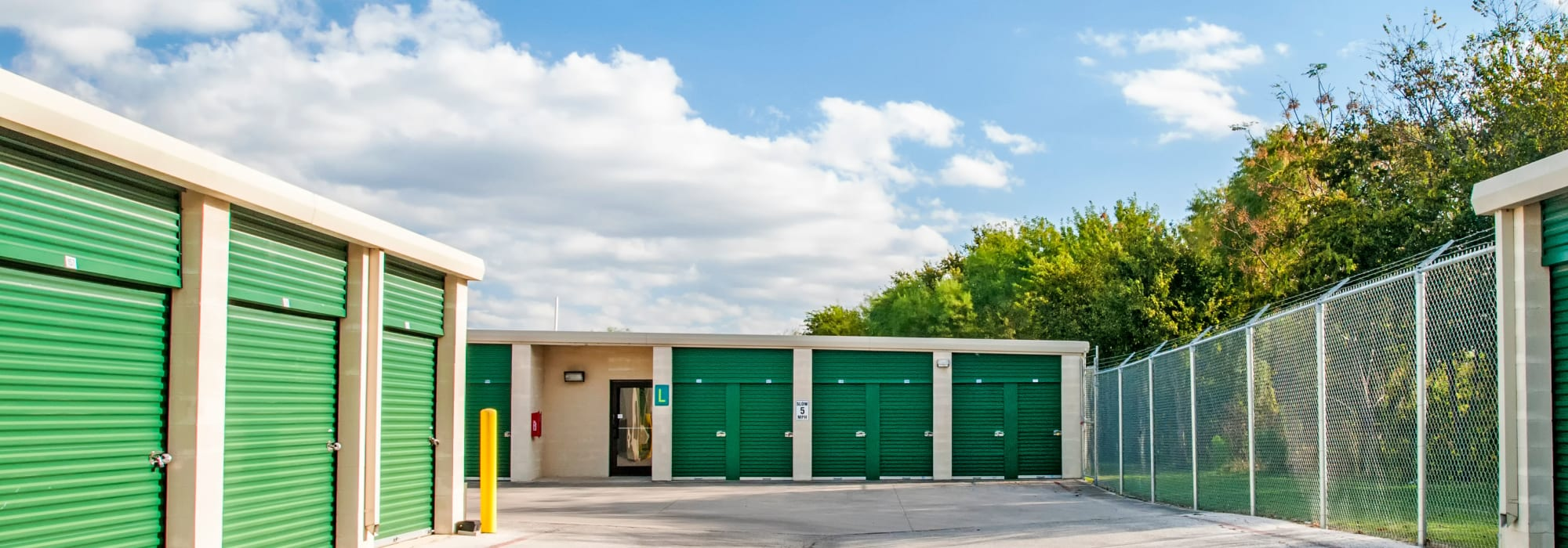 Outside storage units with green doors at Lockaway Storage in San Antonio, Texas