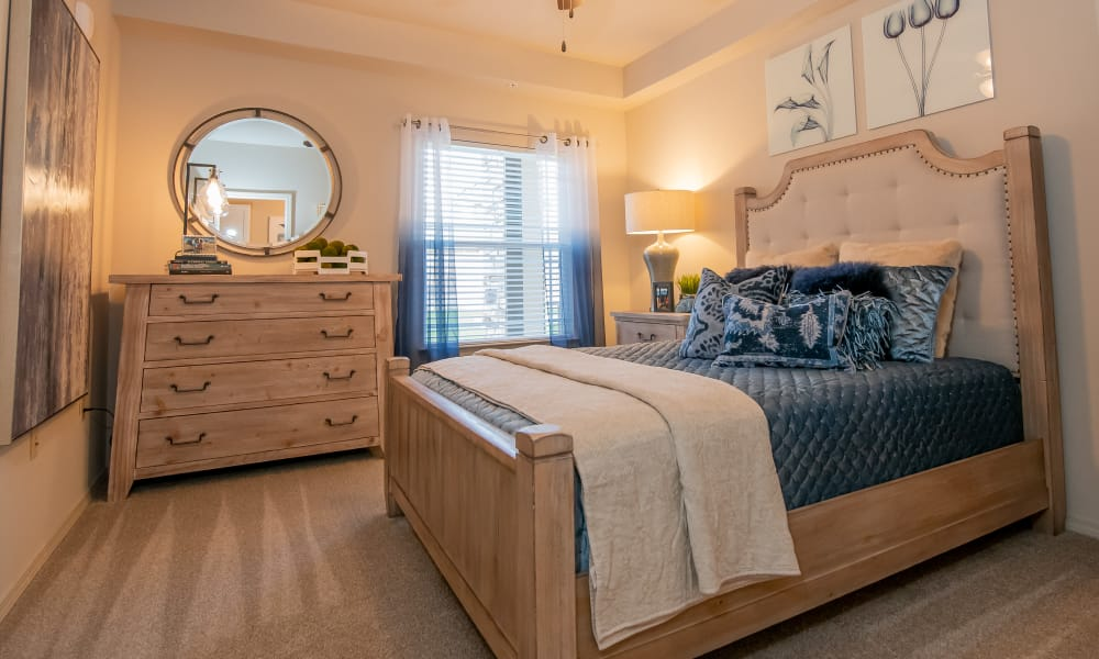 A well decorated bedroom at Stonehorse Crossing Apartments in Oklahoma City, Oklahoma
