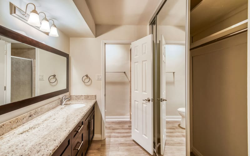 Extra closet space and a large vanity mirror in a model home's bathroom at Mediterranean Village in West Hollywood, California