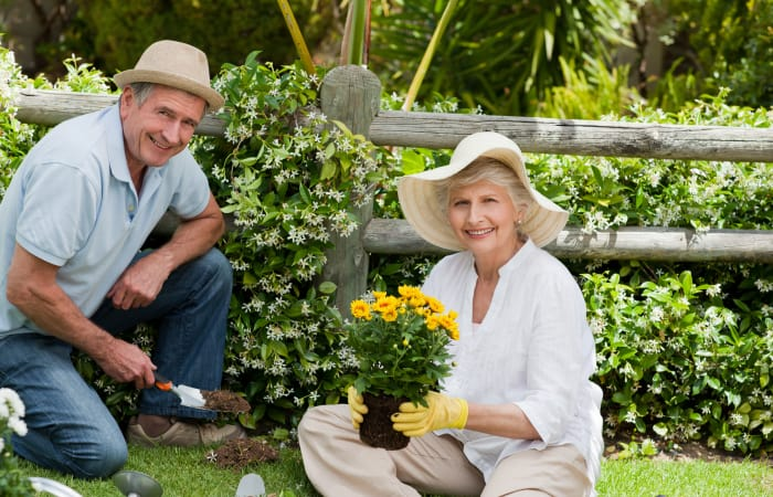Older couple gardening at Stonecrest of Rochester Hills in Rochester Hills