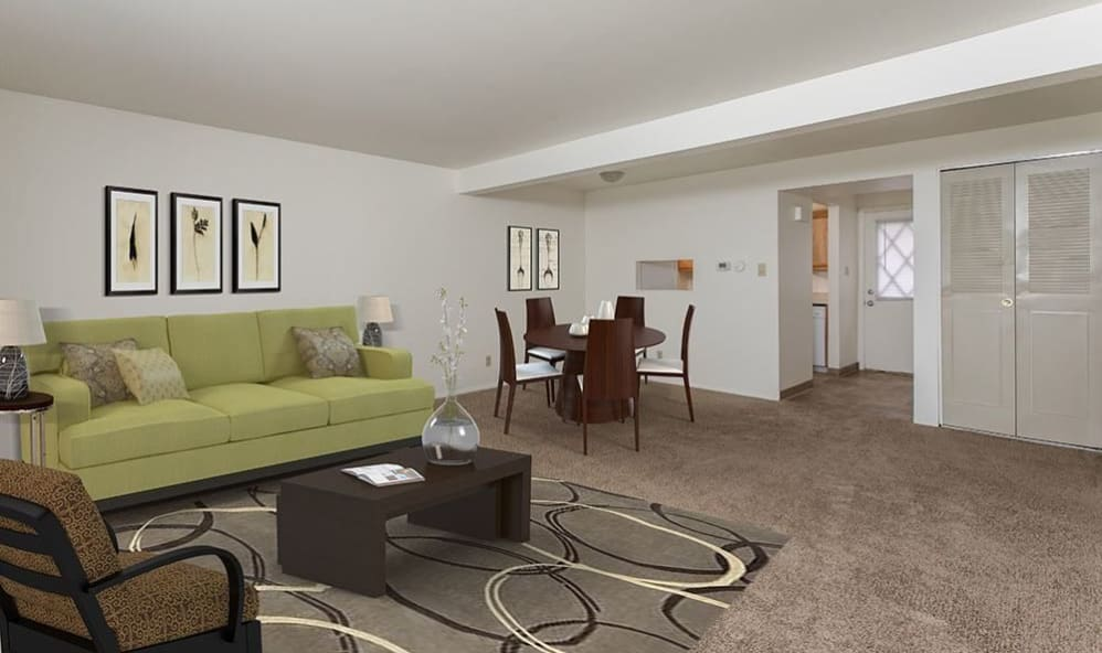 Cozy couch at High Acres Apartments & Townhomes in Syracuse, New York