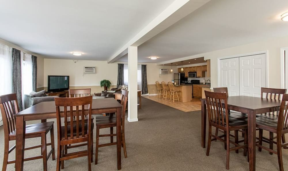 Clubhouse dining tables at High Acres Apartments & Townhomes in Syracuse, New York