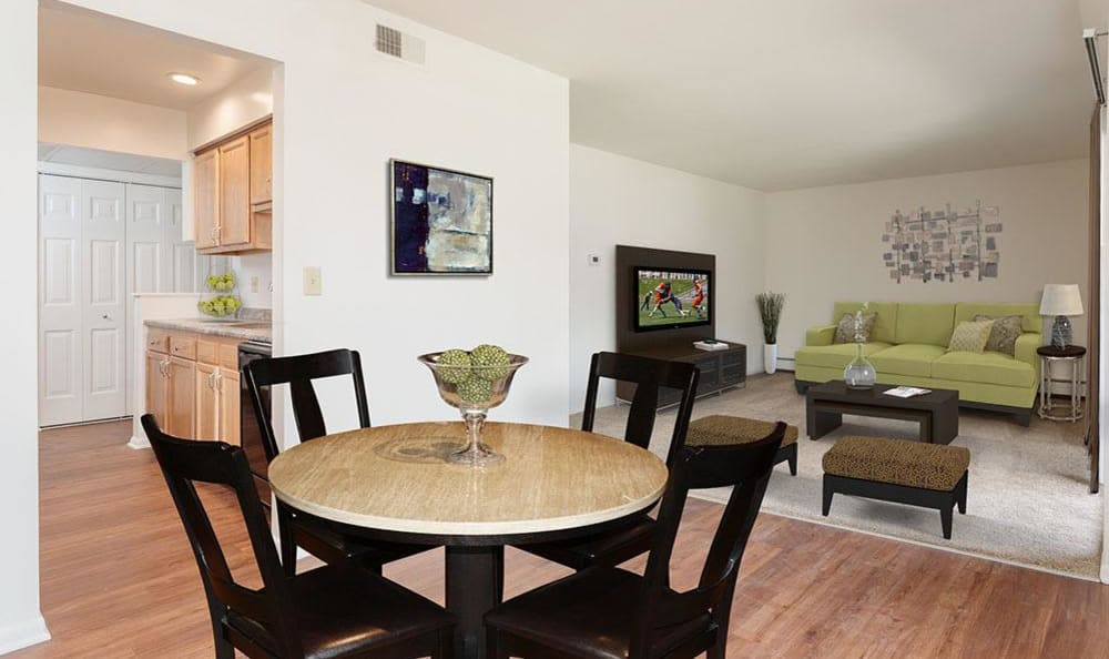 Spacious dining room at Steeplechase Apartments home in Camillus, New York