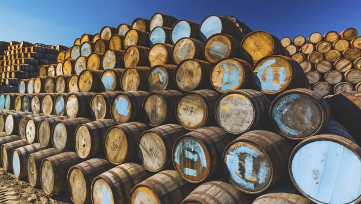 Whiskey in aging barrels at a distillery near The Ranch at Shadow Lake in Houston, Texas