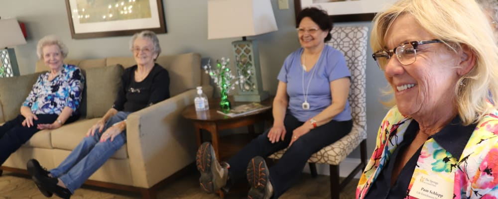 Residents seated doing an activity with caregiver at the front at The Springs at Grand Park in Billings, Montana