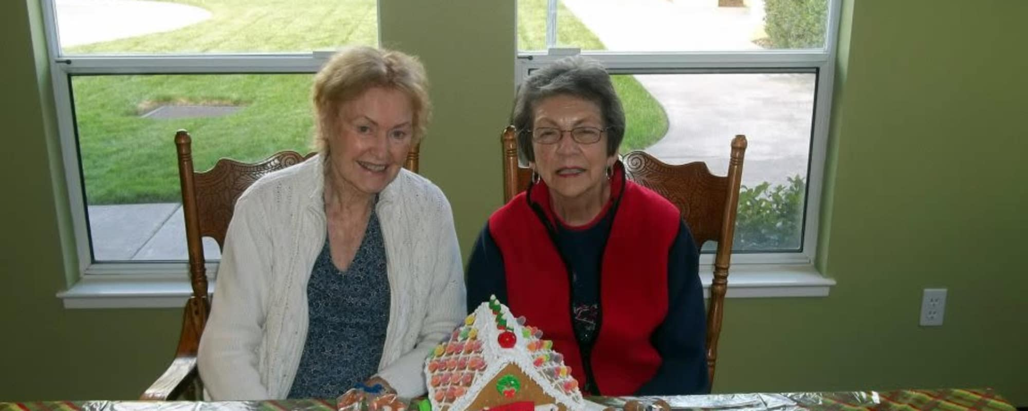 Senior and Gingerbread house at MuirWoods Memory Care in Petaluma, California