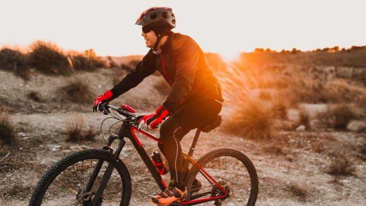 Mountain biker at sunrise on a trail near Olympus at Daybreak in South Jordan, Utah