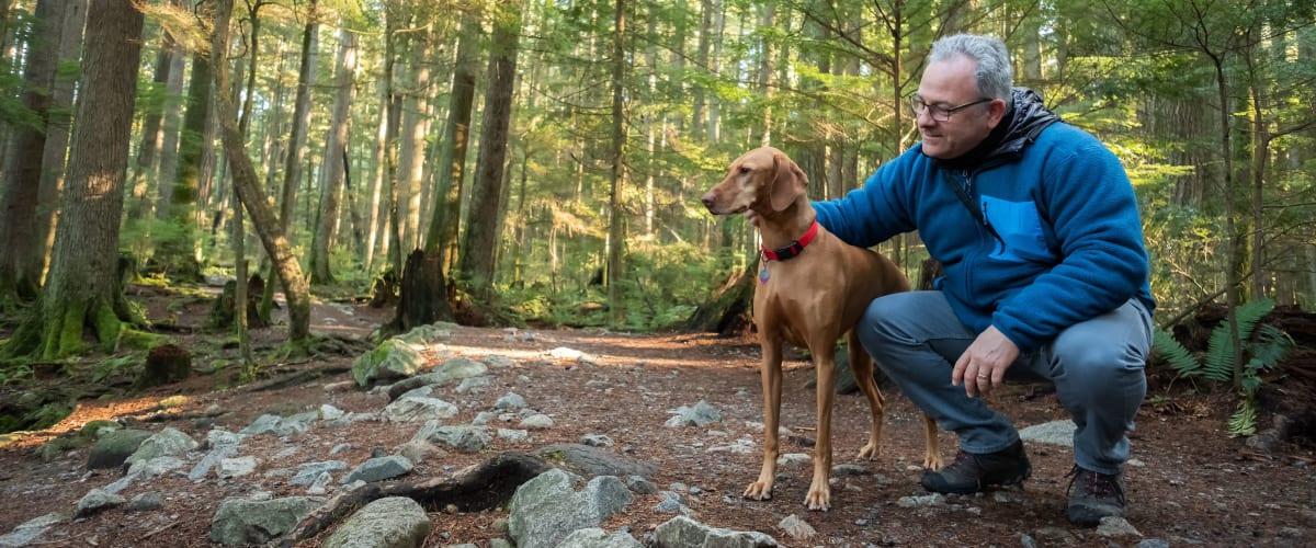 Man out on a hike with his dog at Metropolitan Rockville Town Center in Rockville, Maryland