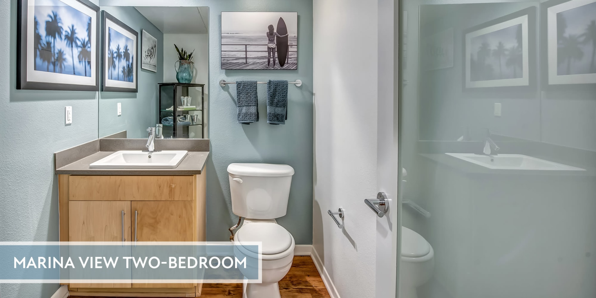 Glass-enclosed stand-up shower in a model home's bathroom at Esprit Marina del Rey in Marina Del Rey, California