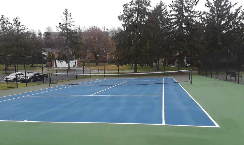 Tennis court offered at The Fairways Apartments and Townhomes In Thorndale, PA