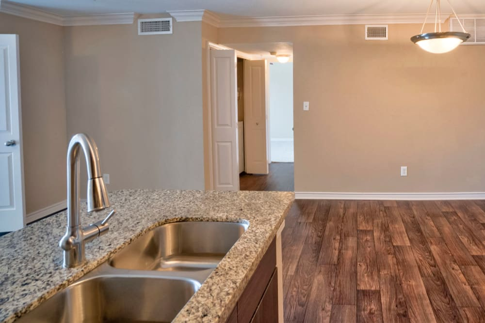 Granite countertops in a model home's kitchen at Southwind at Silverlake Apartments in Pearland, Texas