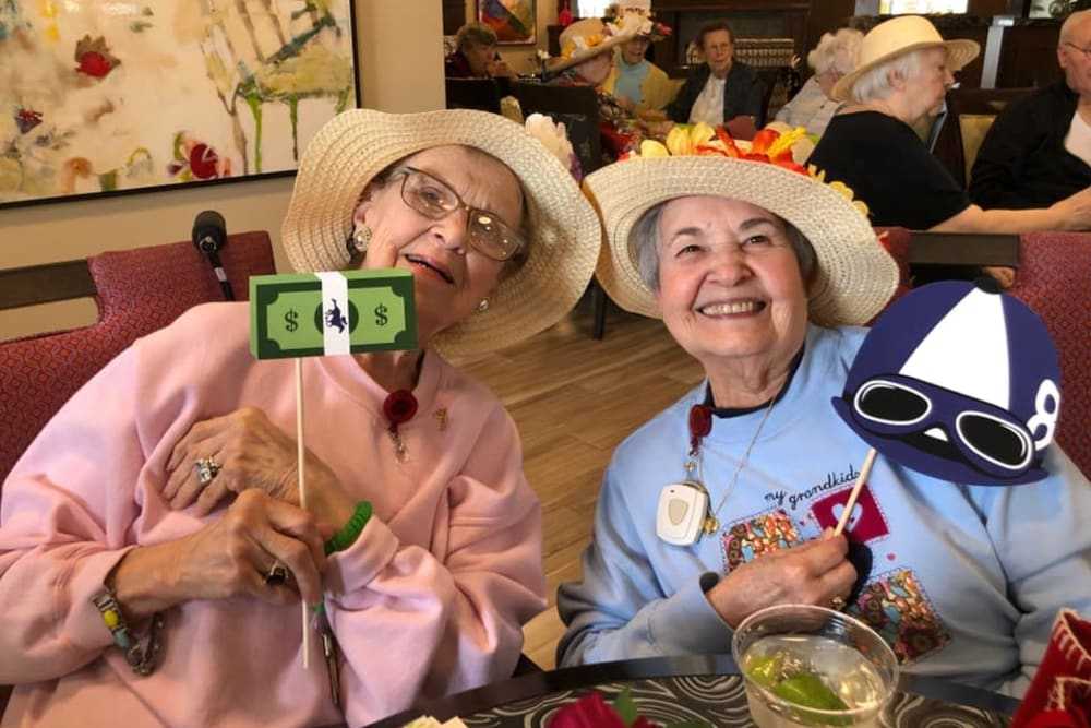 two residents enjoying a party
