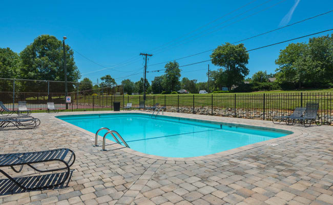 Swimming pool with a paved sundeck at Lakewood Apartment Homes in Salisbury, North Carolina