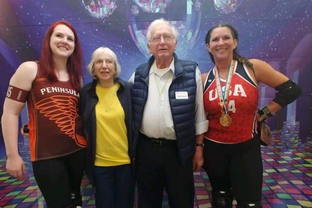Senior residents and Roller Derby team members smiling