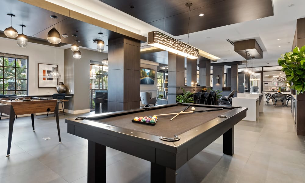 Clubhouse area with pool table for residents to play on at 6600 Main in Miami Lakes, Florida