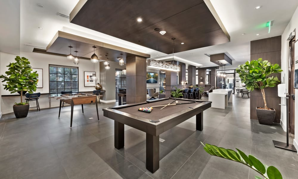 Clubhouse area with a billiards table for residents to use at 6600 Main in Miami Lakes, Florida