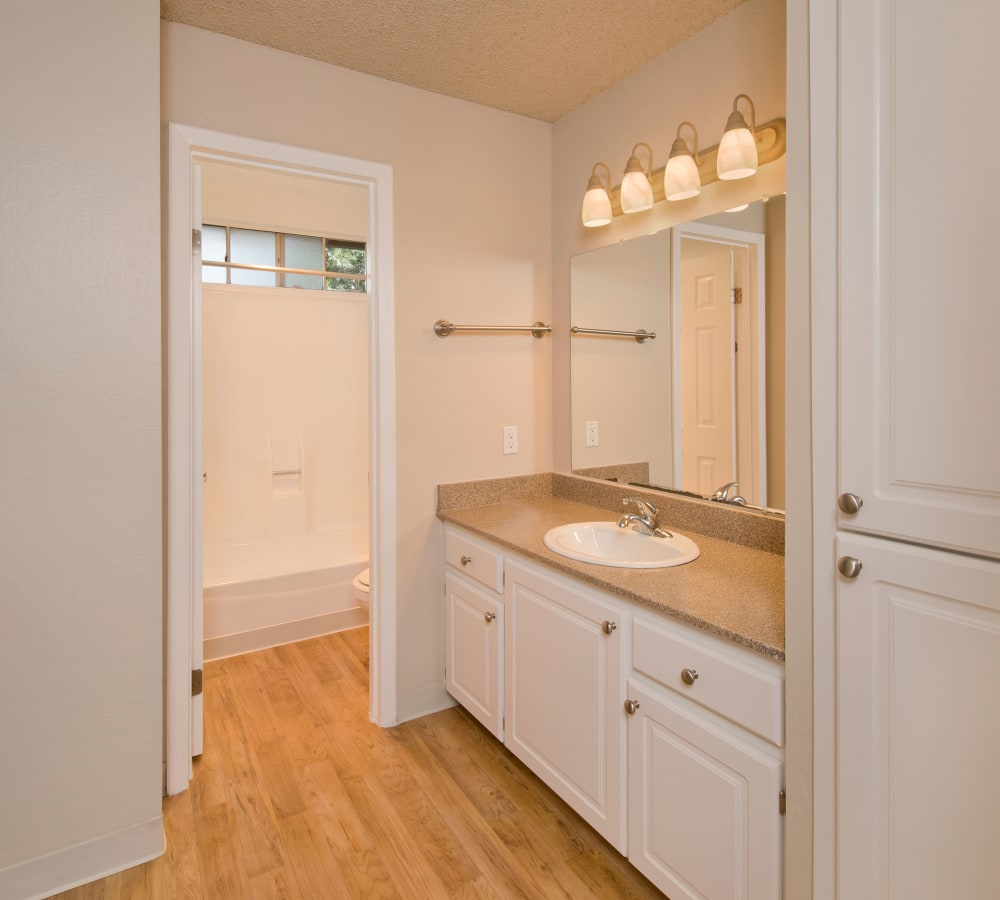 Bathroom with plenty of cabinetry at Shadow Oaks Apartment Homes in Cupertino, California
