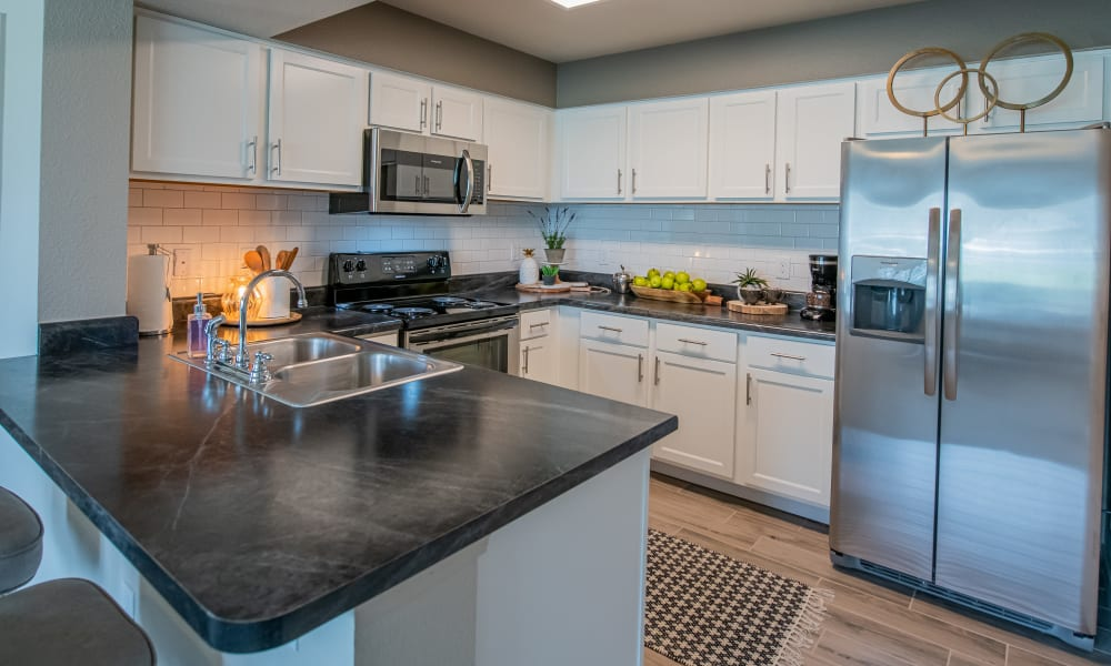 Bright kitchen with wood style flooring at Cottages at Crestview in Wichita, Kansas