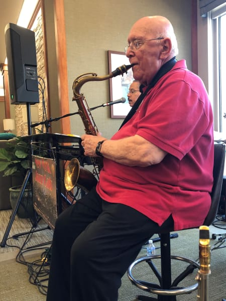 resident playing the sax for the community