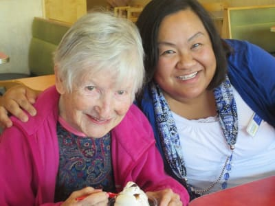 Happy senior women enjoying activities of memory care at at Eastern Star Masonic Retirement Campus in Denver, CO
