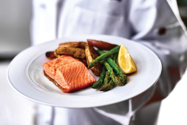 Elegant salmon and asparagus meal at Ashton Gardens Gracious Retirement Living in Portland, Maine