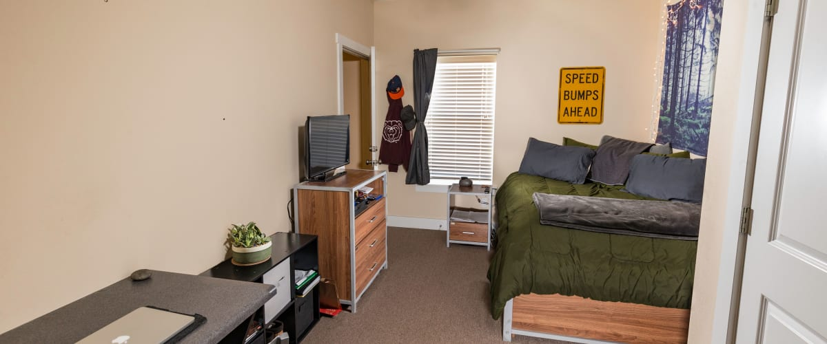 A large bedroom with room to study at Beacon Springfield in Springfield, Missouri