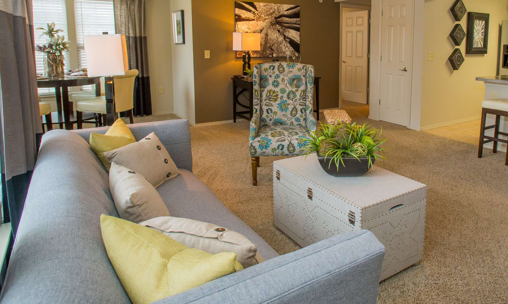 Carpeted living room at Tuscana Bay Apartments in Corpus Christi, Texas